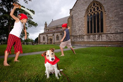 St Asaph Cathedral....North Wales music festival... Pirates at the Cathedral in St Asaph. Pictured are ten year olds Ben and Libby Morgan with Dolly the Dog at St Asaph Cathedral.