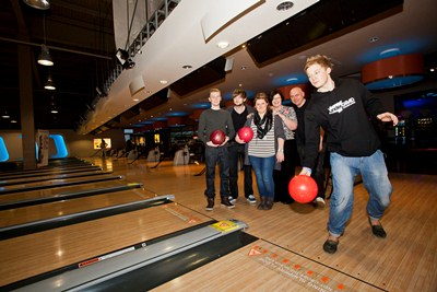Wrexham students are planning a charity Tenpin bowling evening next month at Tenpin at Eagles Meadow next month. James Yarwood bowls watched by, from left, Ryan Harvey, Adam Fuller, Emma Louise Humphreys, Janet Masters, sales manager at Tenpin and Robbie Newby, front of house technician.