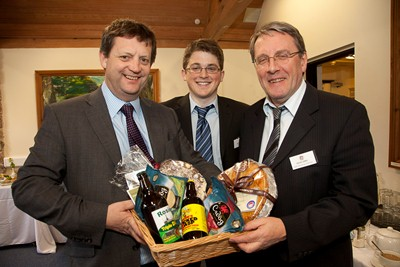 Welsh Government Deputy Minister for Food Alun Davies at the launch of the Clwydian Range Food Trail . Deputy Minister For Food Alun Davies is presented with a food hamper from Robert Price, Cadwyn Clwyd Agri-Food Project Officer for Denbighshire and Flintshire, and David Jones, Chairman of the Food Trail.