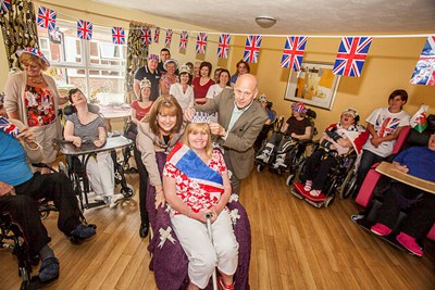 Queen&#039;s Jubilee events at Pendine Park Care Homes. The Queen for a Day at Penybryn, Joanne Davies is crowned by Mario and Gill Kreft